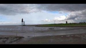 Wurster Nordseeküste mit Leuchtturm in Dorum im Landkreis Cuxhaven